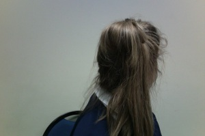Paighton Baker '18 models her messy bun/ pony tail mash-up.