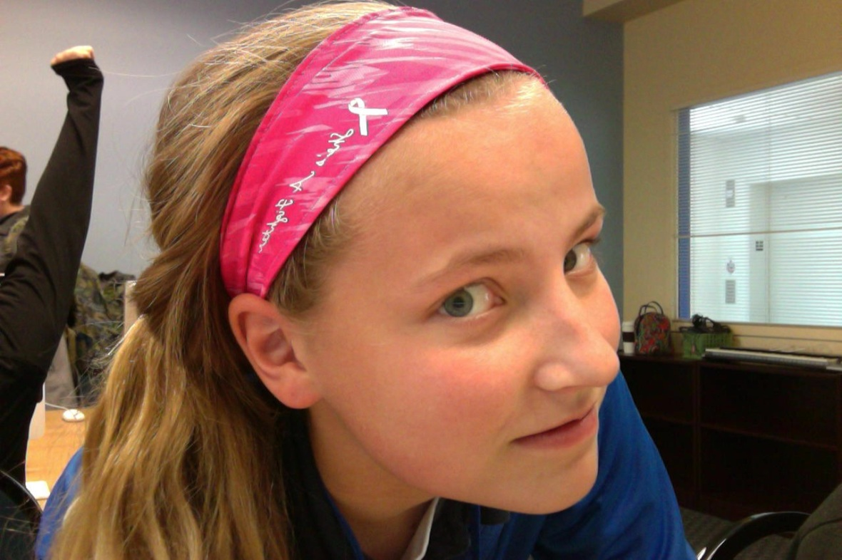 Grace Janszen  sports her super cute headband that supports breast cancer awareness in October.