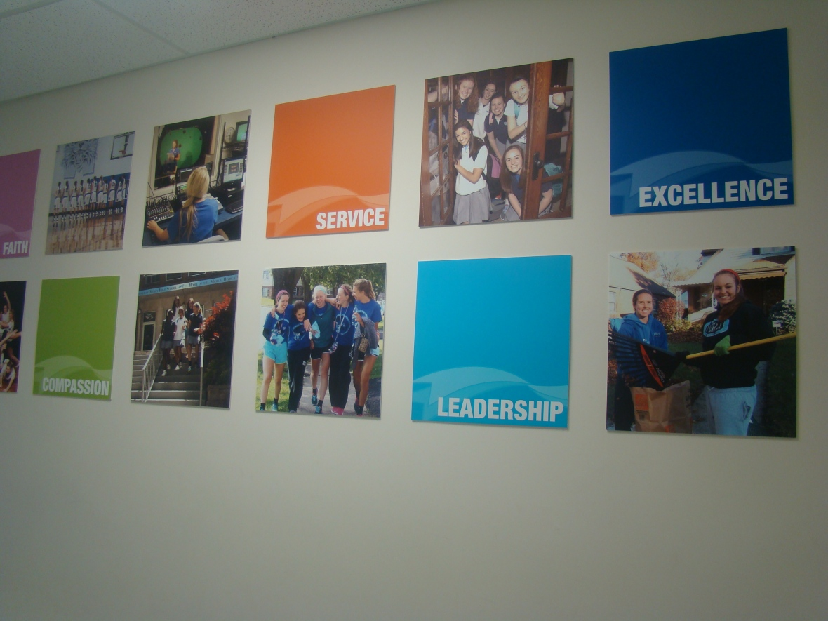 Photographs of past and current Mercy girls located in the tech wing. Photo courtesy Lindsay Eichhold.