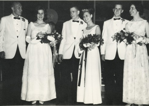 The Bobcats on the 1965 prom court receive flowers in this photo courtesy of the yearbook.