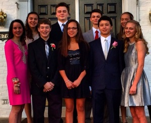 Freshman girls and their dates before their first formal dance at Mercy.