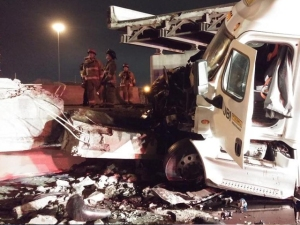 The semi that hit the bridge as it came down. Photo courtesy, USA Today.
