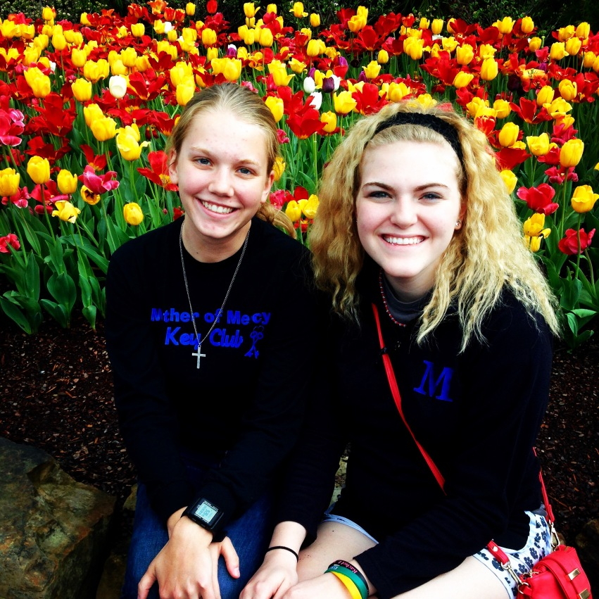Sara Dressman and Casey Tegenkamp '15 stop to smell the flowers at the zoo!