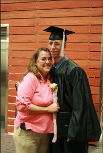 Chris on his college graduation day with his mom.